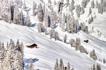 skying: Swiss Wooden Cottages in deep snow, Adelboden, Switzerland Stock Photo