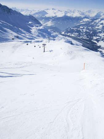 Chairlift and perfect ski slopes in Lenzerheide ski resort Swiss Alps, Grisons, Switzerland