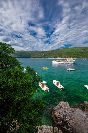 Yachts and a ship in mediterean harbour in a sunny weather, Istria, Croatia