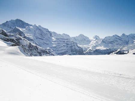 Ski slopes in Grindelwald ski mountain resort under Eiger, Jungfrau and Moench peaks, Bernese Highlands, Switzerland
