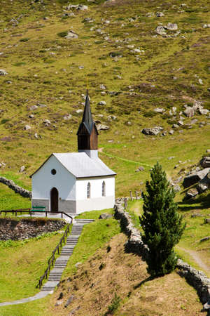 Small chapel in Swiss Alps near Davos, Grisons, Switzerland Stock Photo