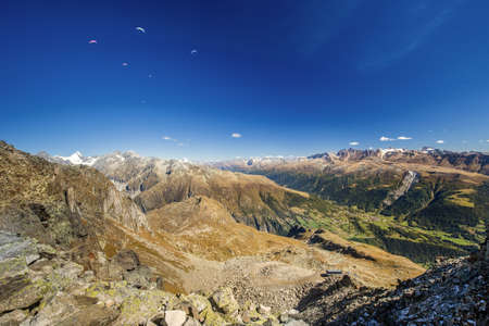 glarus: Paragliders enjoying majestic view to Swiss Alps from the top of Eggishorn mountain, Valais, Switzerland