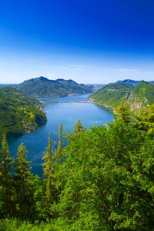 monte: View to Lugano city, Lugano lake and Monte San Salvatore from Monte Bre, Ticino, Switzerland Stock Photo