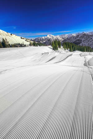 bove: Ski slopes with the corduroy pattern on the top of Fellhorn Ski resort, Bavarian Alps, Oberstdorf, Germany
