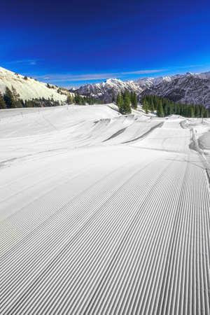 Ski slopes with the corduroy pattern on the top of Fellhorn Ski resort, Bavarian Alps, Oberstdorf, Germany