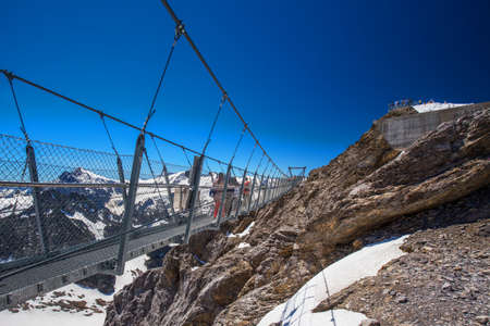 People on Europes highest suspension bridge in Switzerland.