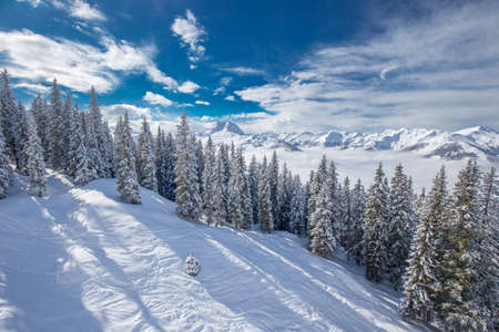 View to Alpine mountains in Austria from Kitzbuehel ski resort - one of the best ski resort in the workd with 54 cable cars, 170 km prepared skiing slopes and place of famous Hahnenkamm race, Tyrol, Austria Stock Photo