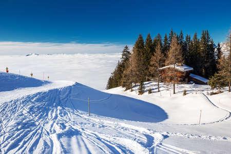 wildkogel austria: Alpine chalet covered by snow in Kitzbuehel ski arena, Tyrol, Austria