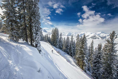 wildkogel austria: View to Alpine mountains in Austria from Kitzbuehel ski resort - one of the best ski resort in the workd with 54 cable cars, 170 km prepared skiing slopes and place of famous hahnenkamm races, Tyrol, Austria Stock Photo