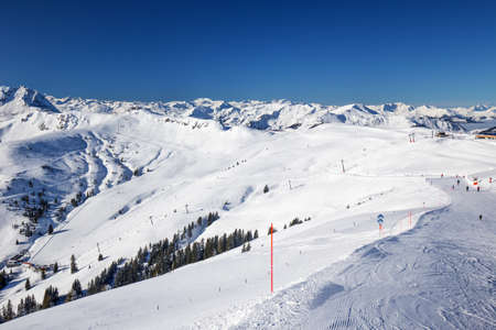 wildkogel austria: View to Alpine mountains and ski slopes in Austria from Kitzbuehel ski resort - one of the best ski resort in the workd with 54 cable cars, 170 km prepared skiing slopes and place of famous hahnenkamm races, Tyrol, Austria