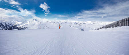 wildkogel austria: Panoramaview to ski slopes and skiers skiing in Kitzbuehel mountain ski resort with a background to Alps in Austria fresh covered by snow, Tyrol, Austria