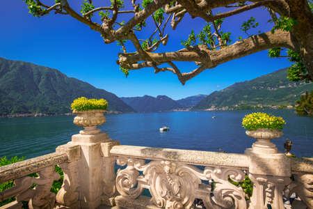 classy house: Beautiful view to Como lake and Alps from terrace Villa Balbianello, Italy. Stock Photo