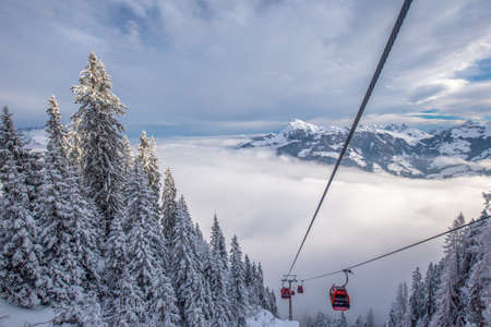 wildkogel austria: View to Alps in Austria from cable car leading to Hahnenkamm, place of famous hahnenkamm races. Kitzbuehel ski resort is one of the best ski resort in the world with 54 cable cars and 170 km prepared skiing slopes, Tyrol, Austria