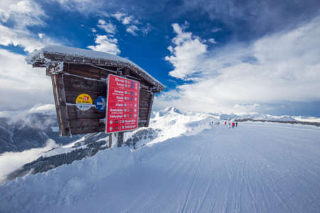 wildkogel austria: Skiers skiing in Kitzbuehel ski resort with 54 cable cars and 170 km prepared skiing slopes, place of famous Hahnenkamm races, Tyrol, Austria Editorial