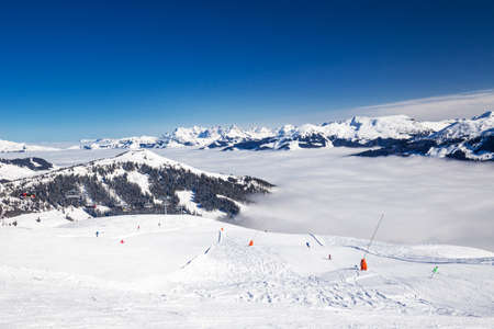 wildkogel austria: View to Alpine mountains and ski slopes in Austria from famous Kitzbuehel ski resort with 54 cable cars, 170 km prepared skiing slopes and place of famous Hahnenkamm races, Tyrol, Austria