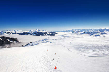 wildkogel austria: View to Alpine mountains in Austria from Kitzbuehel ski resort - one of the best ski resort in the workd with 54 cable cars, 170 km prepared skiing slopes and place of famous hahnenkamm races, Tyrol, Austria. Stock Photo