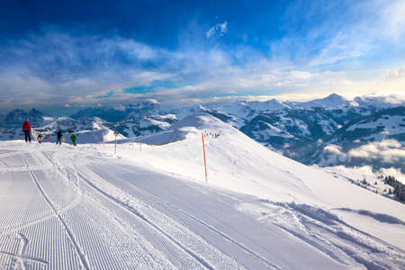 wildkogel austria: Skiers skiing in Steinbergkogel - Kitzbuehel ski resort with 54 cable cars, 170 km prepared skiing slopes and place of famous hahnenkamm races, Tyrol, Austria