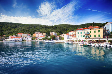 View to the village Valun with harbor and boats, Cres island, Croatia 免版税图像