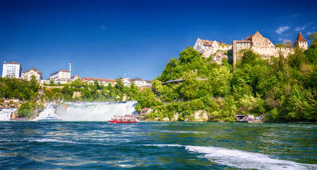 View to Rhine falls (Rheinfalls), the largest plain waterfall in Europe.  It is located near the town of Schaffhausen in northern Switzerland, between the cantons of Schaffhausen and Zürich