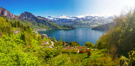 Panorama view to village Vitznau, lake Lucerne (Vierwaldstattersee) and Swiss Alps near Luzern city. Stock Photo