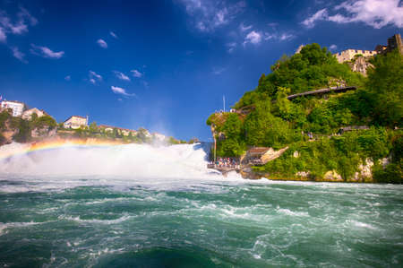 View to Rhine falls (Rheinfalls), the largest plain waterfall in Europe. It is located near Schaffhausen, between the cantons of Schaffhausen and Zurich Stock Photo