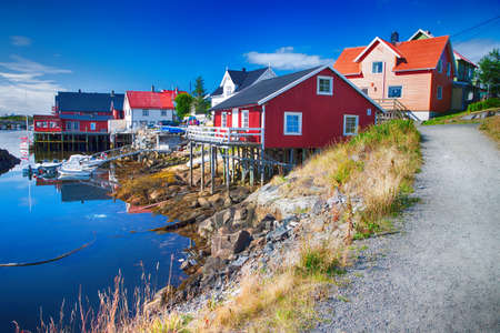 View to typical village with wooden houses in Henningsvaer, Lofoten. Stock Photo
