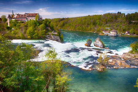 View to Rhine falls near Schaffhausen, Switzerland. Rhine falls is the largest plain waterfall in Europe. Stock Photo