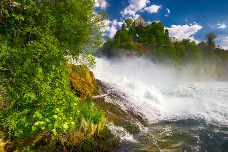 cantons: View to Rhine falls (Rheinfalls), the largest plain waterfall in Europe. It is located near Schaffhausen, between the cantons of Schaffhausen and Zurich Stock Photo