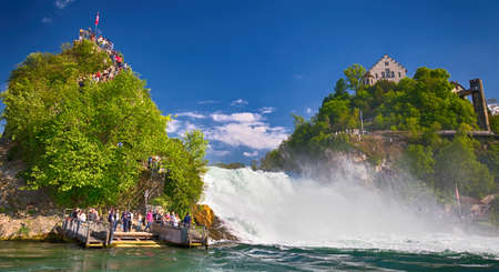 View to Rhine falls (Rheinfalls), the largest plain waterfall in Europe. It is located near Schaffhausen, between the cantons of Schaffhausen and Zurich Editorial