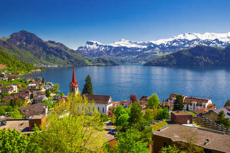 Panorama image of village Weggis, lake Lucerne (Vierwaldstatersee), Pilatus mountain and Swiss Alps in the background near famous Lucerne (Luzern) city, Switzerland Stock Photo