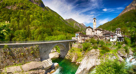 View to Lavertezzo village, famous Swiss village with double arch stone bridge at Ponte dei Salti with waterfall, Lavertezzo, Verzascatal, Canton Tessin.