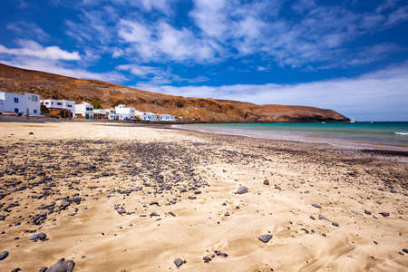 Fishing village Pozo Negro with stone and sand beach, Fuerteventura, Canary Island, Spain. Stock Photo