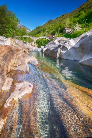 Double arch stone bridge at Ponte dei Salti with waterfall, Lavertezzo, Verzascatal, Canton Tessin.