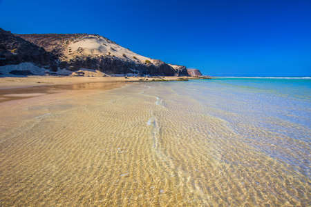 Sotavento sandy beach with vulcanic mountains in the background, Jandia, Fuerteventura, Canary Islands, Spain
