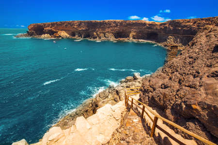 View to Ajuy coastline with vulcanic mountains on Fuerteventura island, Canary Islands, Spain. 免版税图像