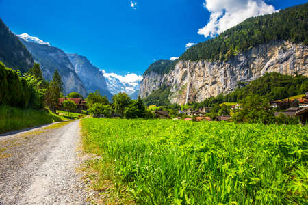 eiger: Famous Lauterbrunnen valley with gorgeous waterfall and Swiss Alps in the background, Berner Oberland, Switzerland, Europe.