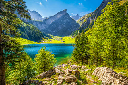 View to tourquise clear Seealpsee with the Swiss Alps (mountain Santis) in the background, Appenzeller Land, Switzerland Stock Photo