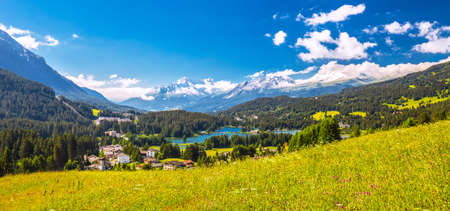 Panorama View to Lenzerheide village with Haidisee, Arose Rothorn and Swiss Alps. Lenzerheide is a mountain resort in canton Graubunden, Switzerland.