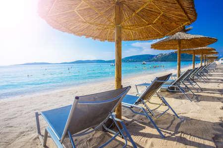 Beach chairs with a white sand on San Ciprianu beach near Porto-Vecchio in Corsica, France, Europe Stock Photo