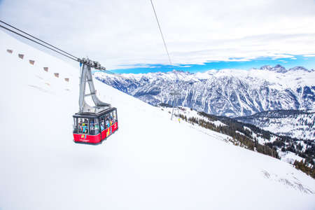 Skiers in cable car enjoying stunning view to Bavarian Alps, Fellhorn, Oberstdorf, Germany. Editorial