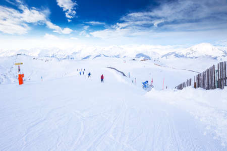 wildkogel austria: View to Tyrolian Alps and ski slopes in Austria from famous Kitzbuehel ski resort with 54 cable cars, 170 km prepared skiing slopes and place of famous Hahnenkamm races. Stock Photo