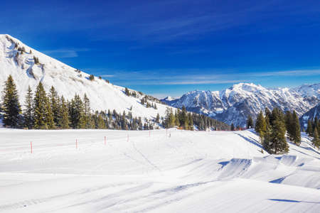 View to Ski slopes with the corduroy pattern and ski chairlifts on the top of Fellhorn Ski resort, Bavarian Alps, Oberstdorf, Germany Stock Photo