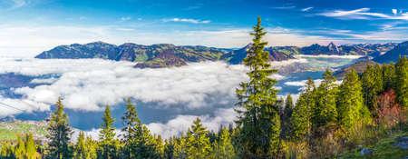 Fog surrounding Grosser, Kleiner Mythen, Lake Lucerne, Rigi mountain, Brunnen city and Weggis village from Klewenalp Swiss Alps, Central Switzerland Stock Photo