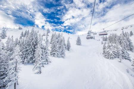 wildkogel austria: Chair lift in Austria Alps with beautiful snowy country panorama in famous Kitzbuhel mountain ski resort, Austria, Europe.