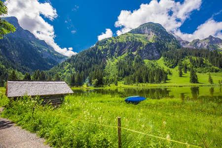 View to Lauenensee lake near Gstaad, Berner Oberland, Switzerland, Europe.