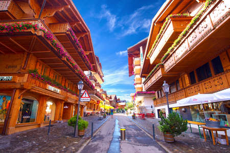 Old city center of Gstaad town, famous ski resort in canton Bern, Switzerland.