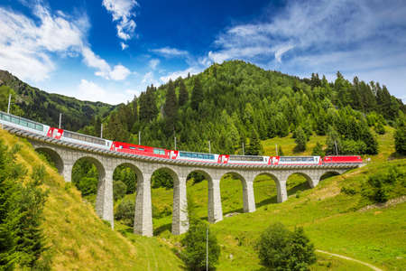 Train on famous landwasser Viaduct bridge.The Rhaetian Railway section from the AlbulaBernina area (the part from Thusis to Tirano, including St Moritz) was added to the list of UNESCO World Heritage Sites, Switzerland, Europe. 版權商用圖片