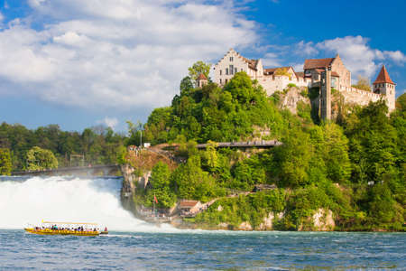 castle rock: View to Rhine falls (Rheinfalls), the largest plain waterfall in Europe. It is located near Schaffhausen, between the cantons of Schaffhausen and Zurich in Switzerland