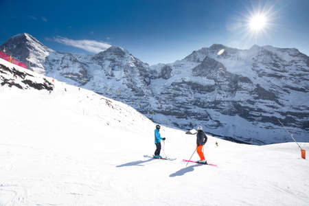 monch: Swiss ski Alpine mountain resort with famous Eiger, Monch and Jungfrau mountain, Grindelwald, Berner Oberland, Grindelwald, Switzerland.