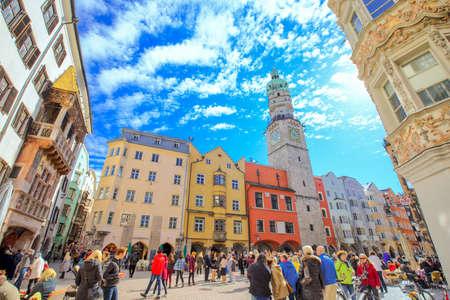 NNSBRUCK, AUSTRIA - March 11, 2017 - People in Innsbruck city center under Stadtturm tower. It is capital city of Tyrol in western Austria, Europe. Editorial